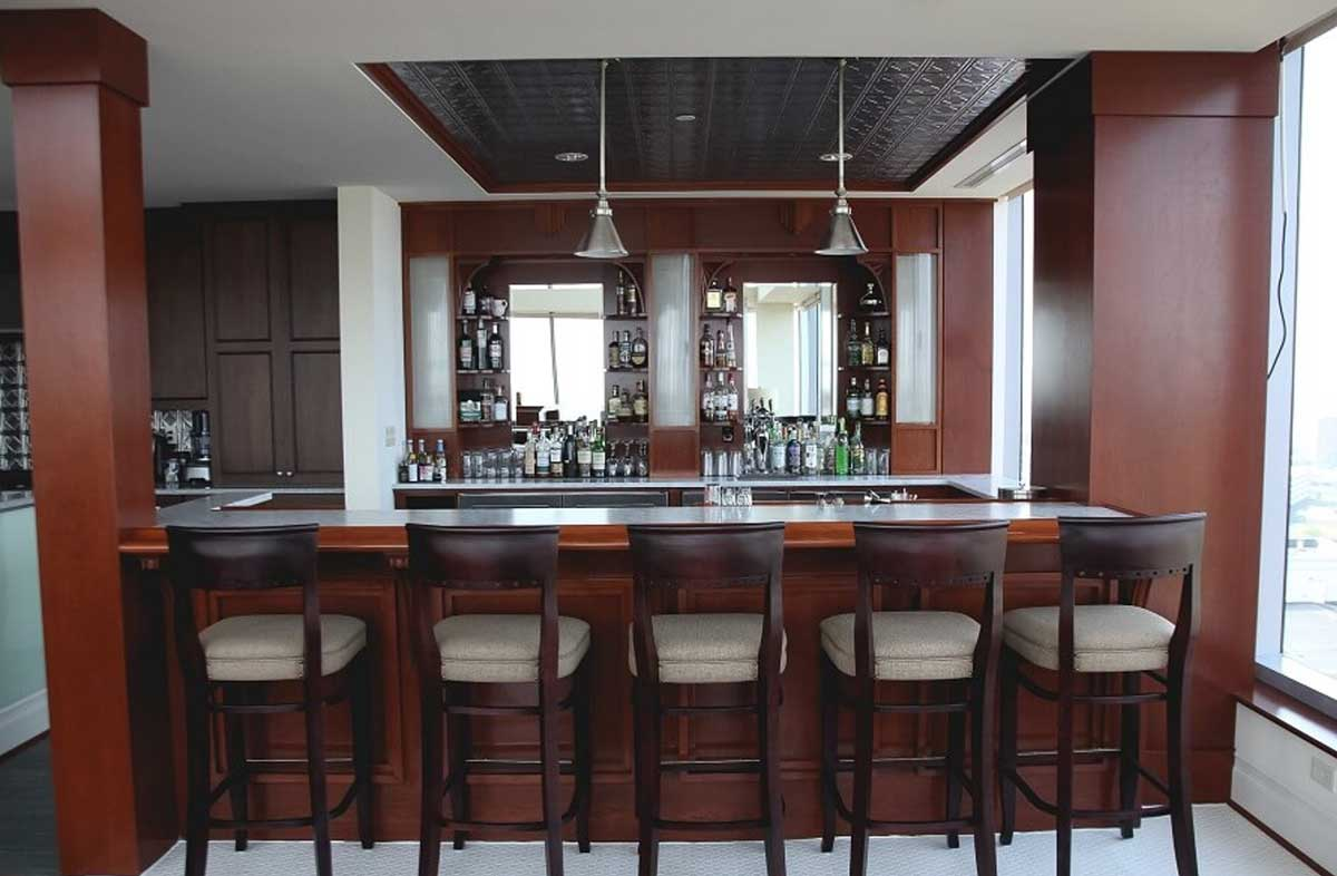 A wall hanging customized kitchen bar will add a lot of class to your kitchen