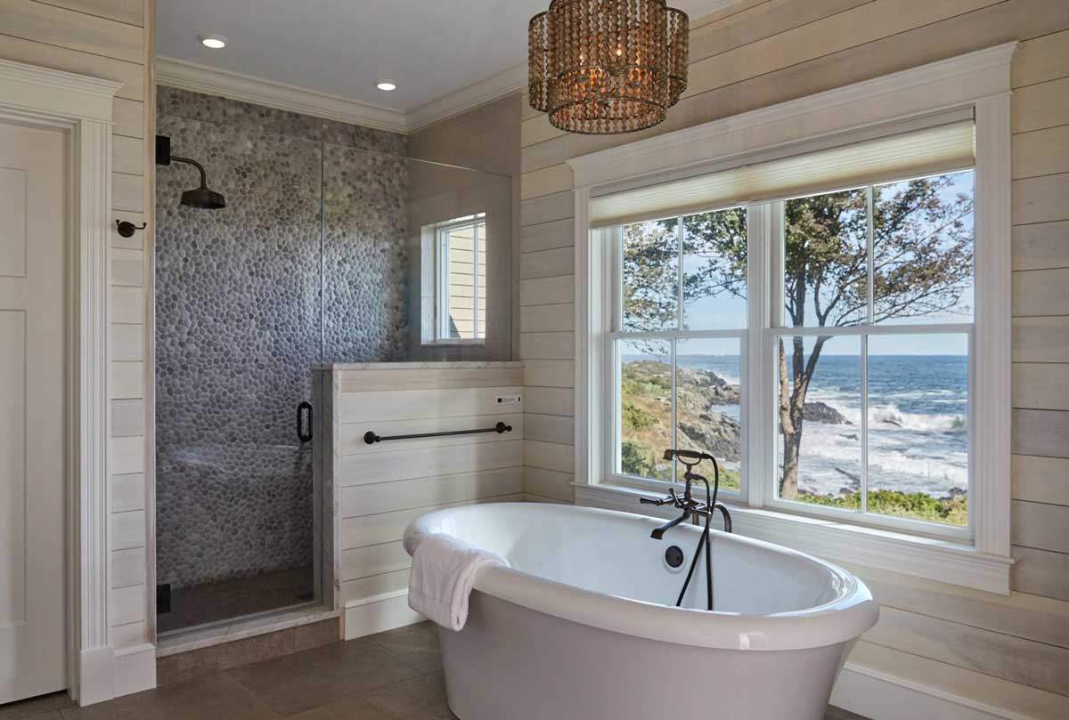 Have pebbles fitted on the wall and the bathtub as well to create beach vibes